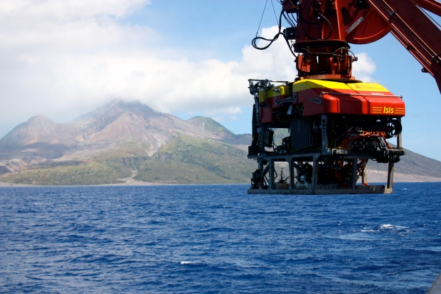 ROV Isis launching with the Soufriere Hills volcano behind. Photo credit: Diva Amon.