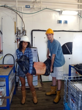 Dr. Adrian Glover and I loading a pig carcass onto the ship.