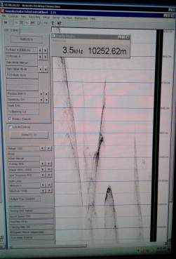 In case we forgot we were working in the deepest area on the planet! The depth read-out as the ship crossed the Mariana Trench. Photo credit: Roland Brian